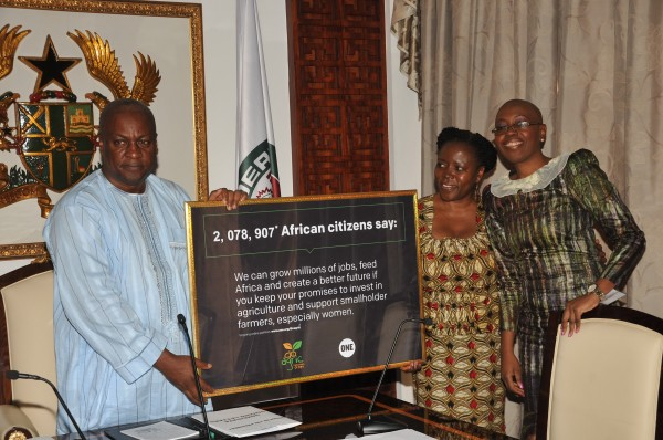 President Dramani Mahama receives the petition from Dr Sipho Moyo, ONE Africa, Executive Director and Nachilala Nkombo, Deputy Director.