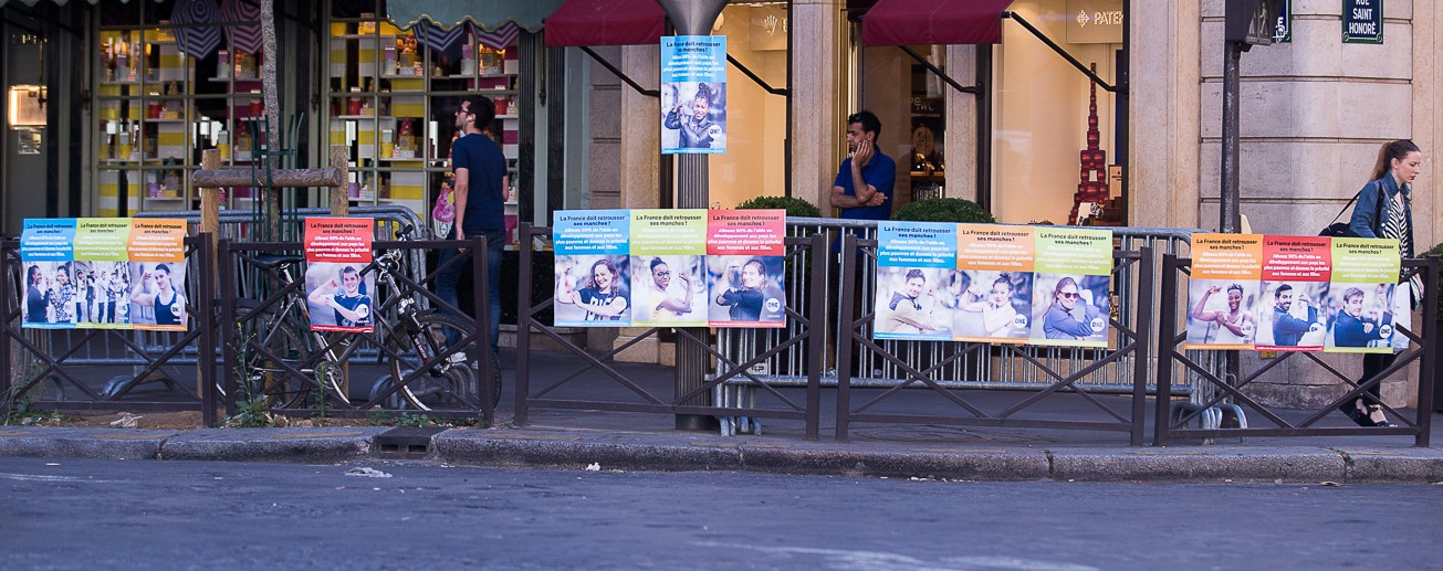 Postering Paris to let leaders know Poverty is Sexist